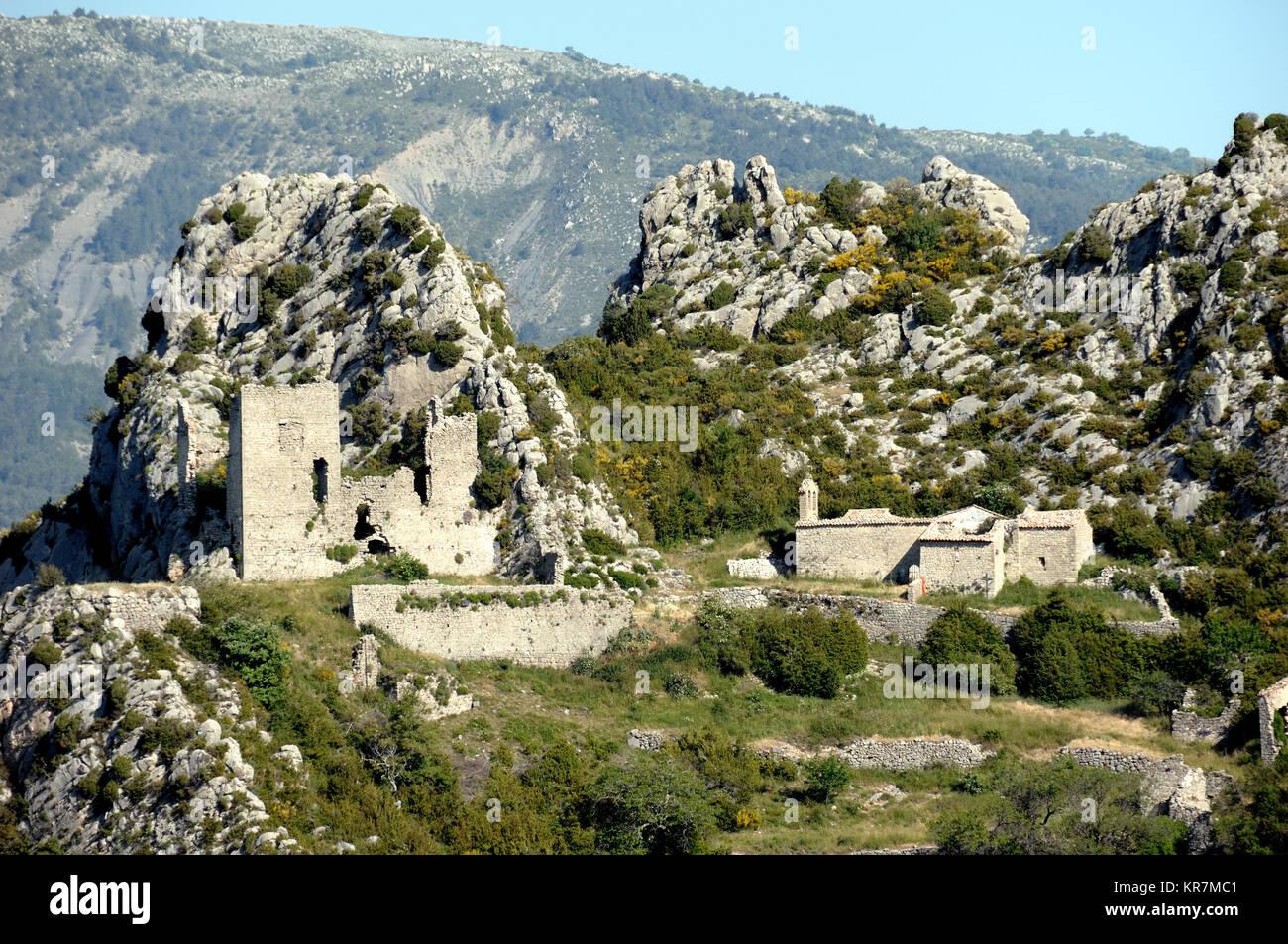 Abandoned Village of la Ville, part of Demandolx Village, with Ruined Medieval Castle above Lake Castillon, near - Stock Image