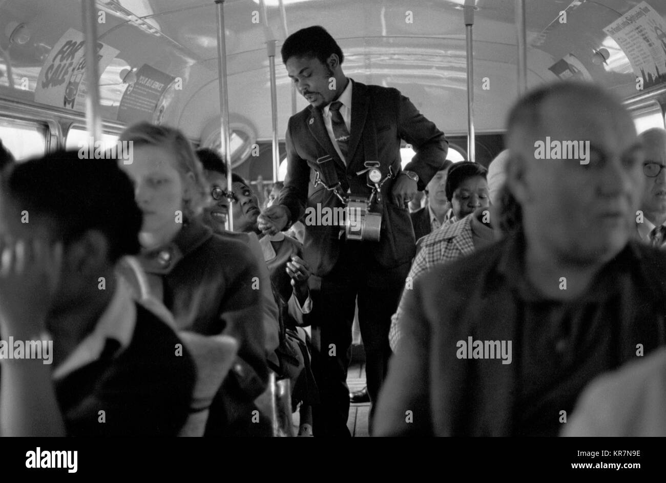 Bus conductor Uk 1970s multi ethnic Britain 70S HOMER SYKES - Stock Image