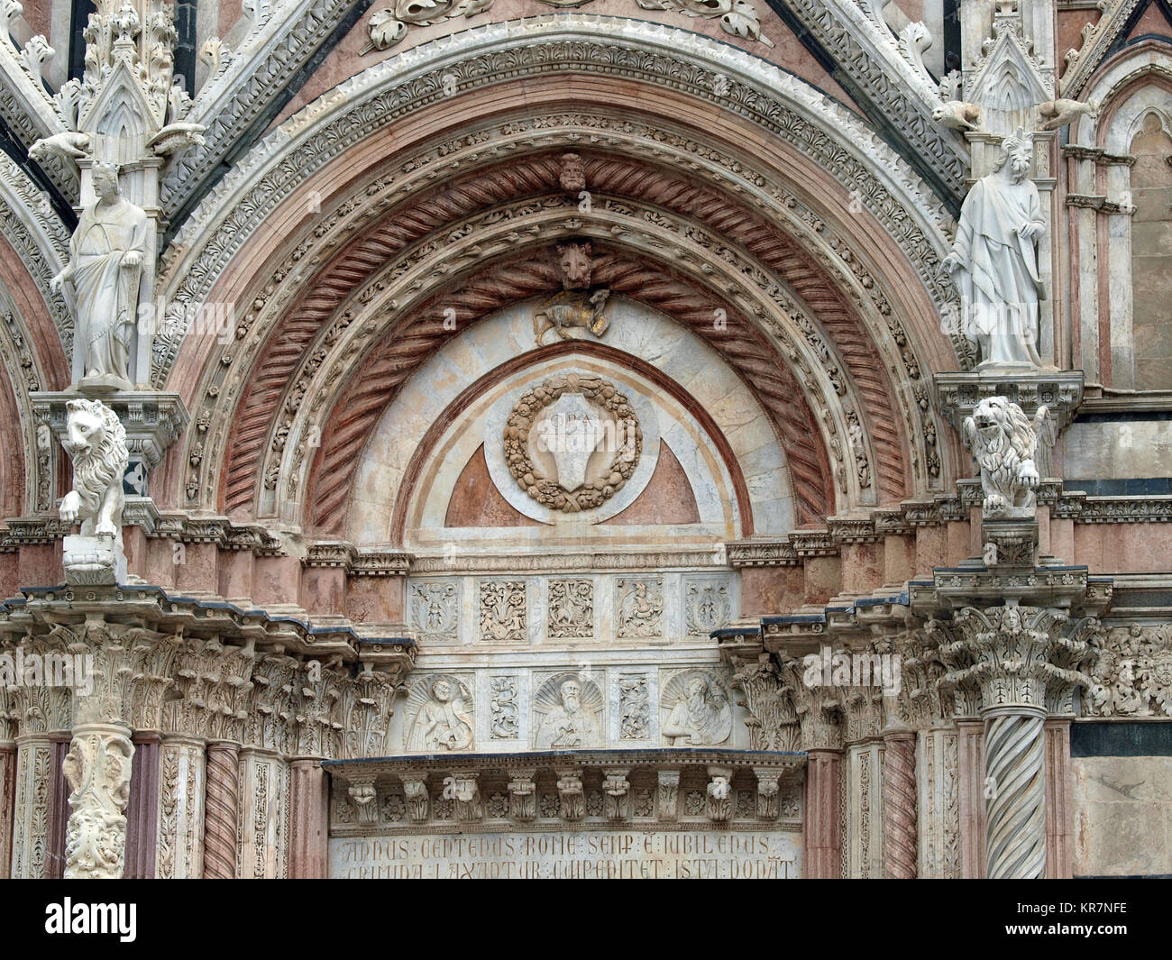 Siena - marble Duomo portal. The Duomo of Siena, which was built in the 12th and 13th centuries, is one of the prettiest - Stock Image
