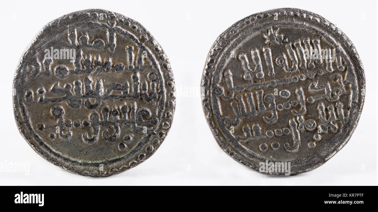 Ancient medieval silver quirat coin of Almoravids. Minted in the ancient Al-Andalus at present Spain. - Stock Image