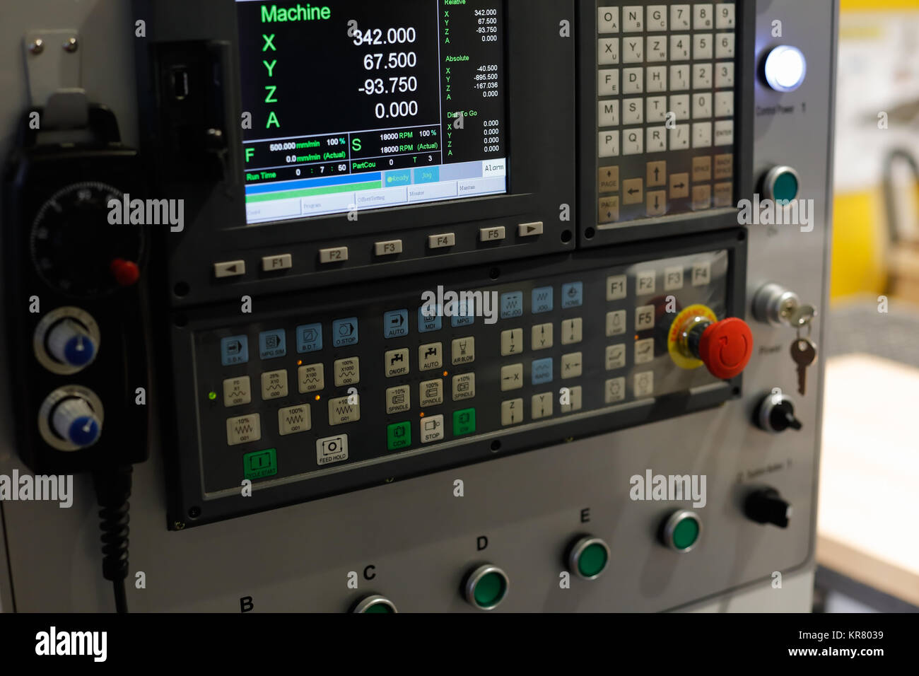 Control panel of the CNC machine. Selective focus. - Stock Image