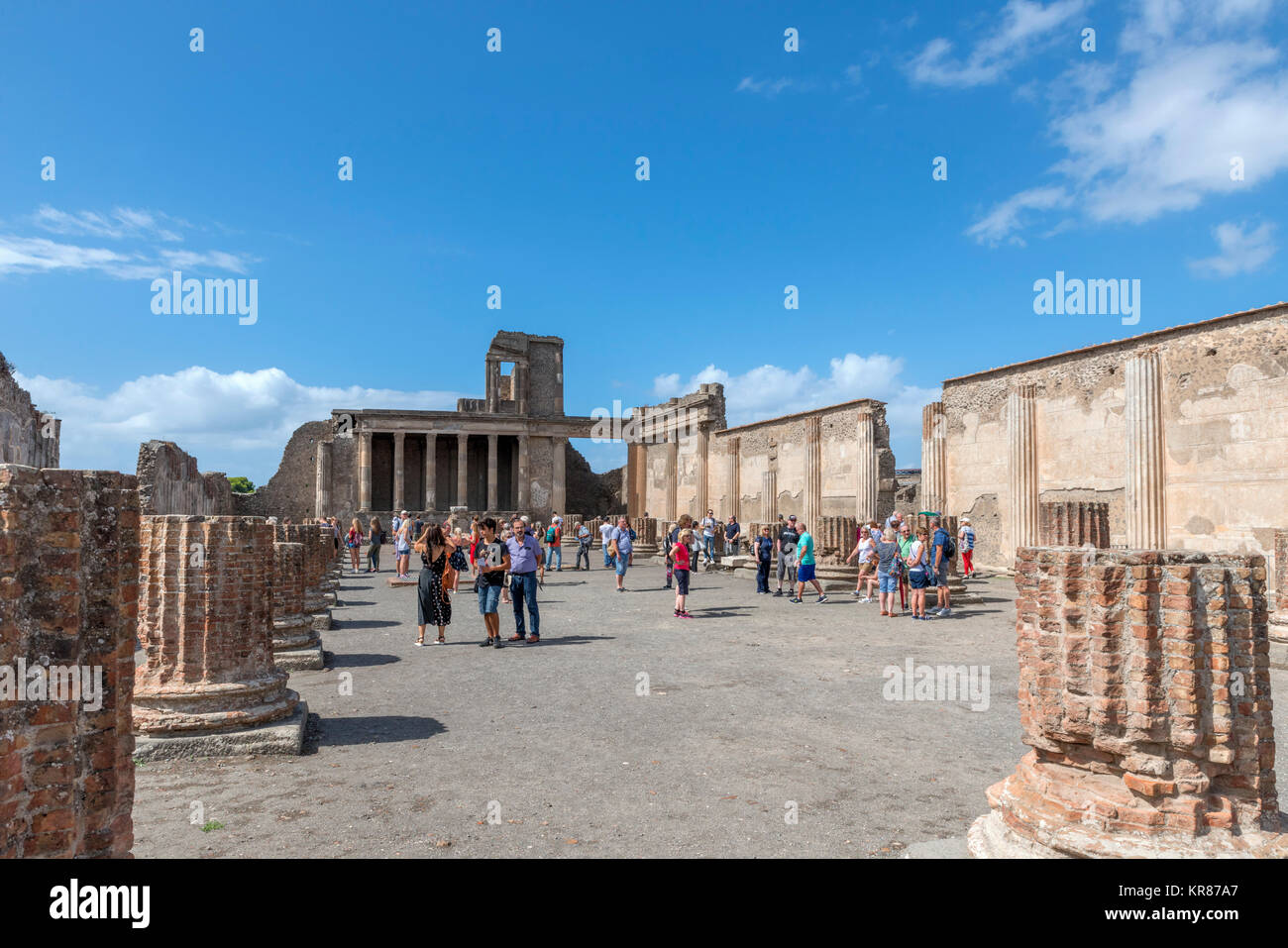 Tourists in the ruins of the Roman Forum at Pompeii ( Pompei ), Naples, Campania,Italy - Stock Image