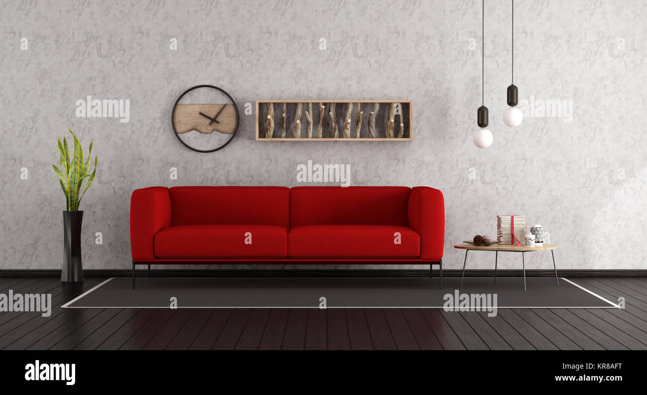 Minimalist living room with red sofa and dark wooden floor ...