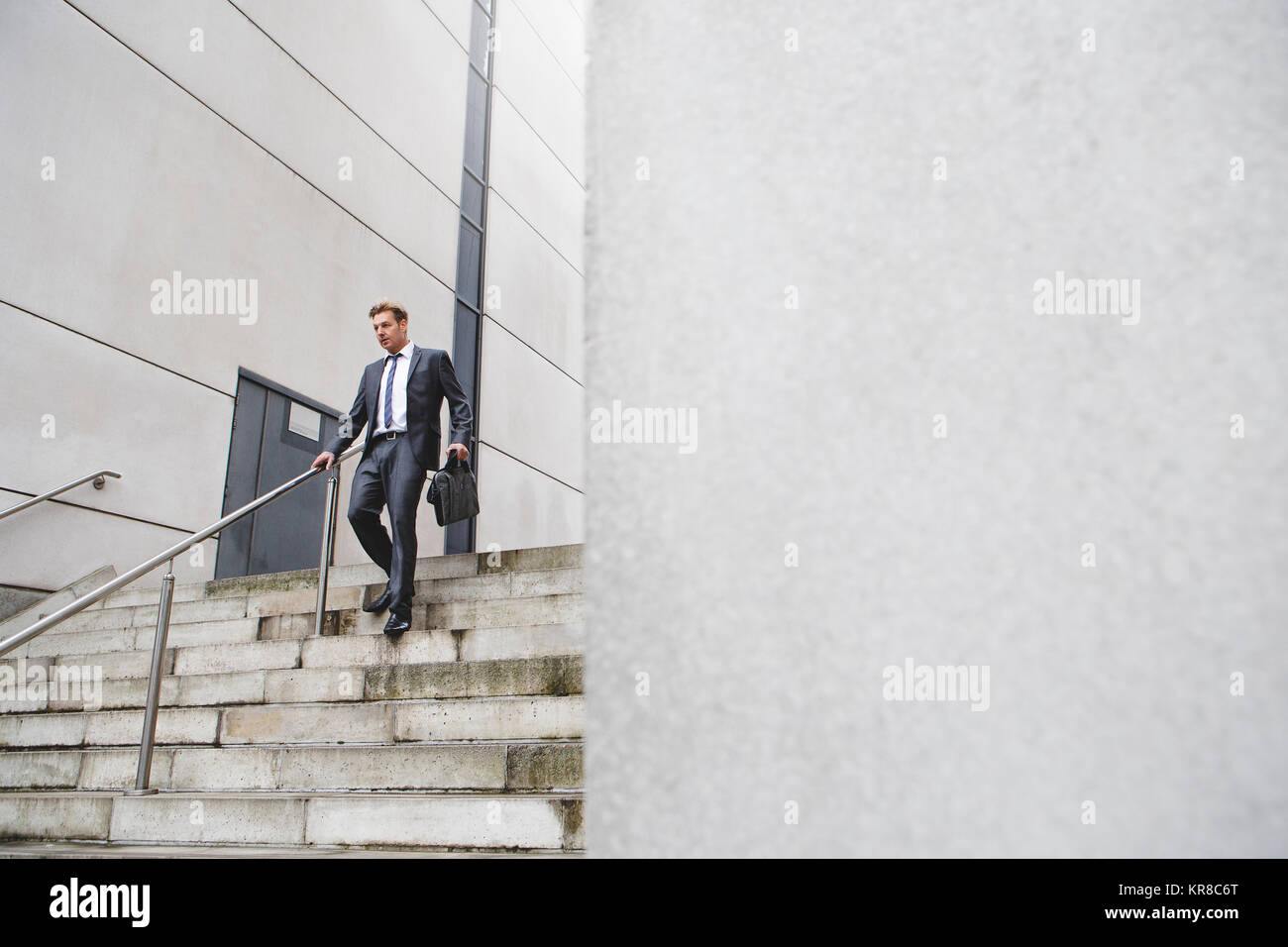 Businessman on the stairs - Stock Image