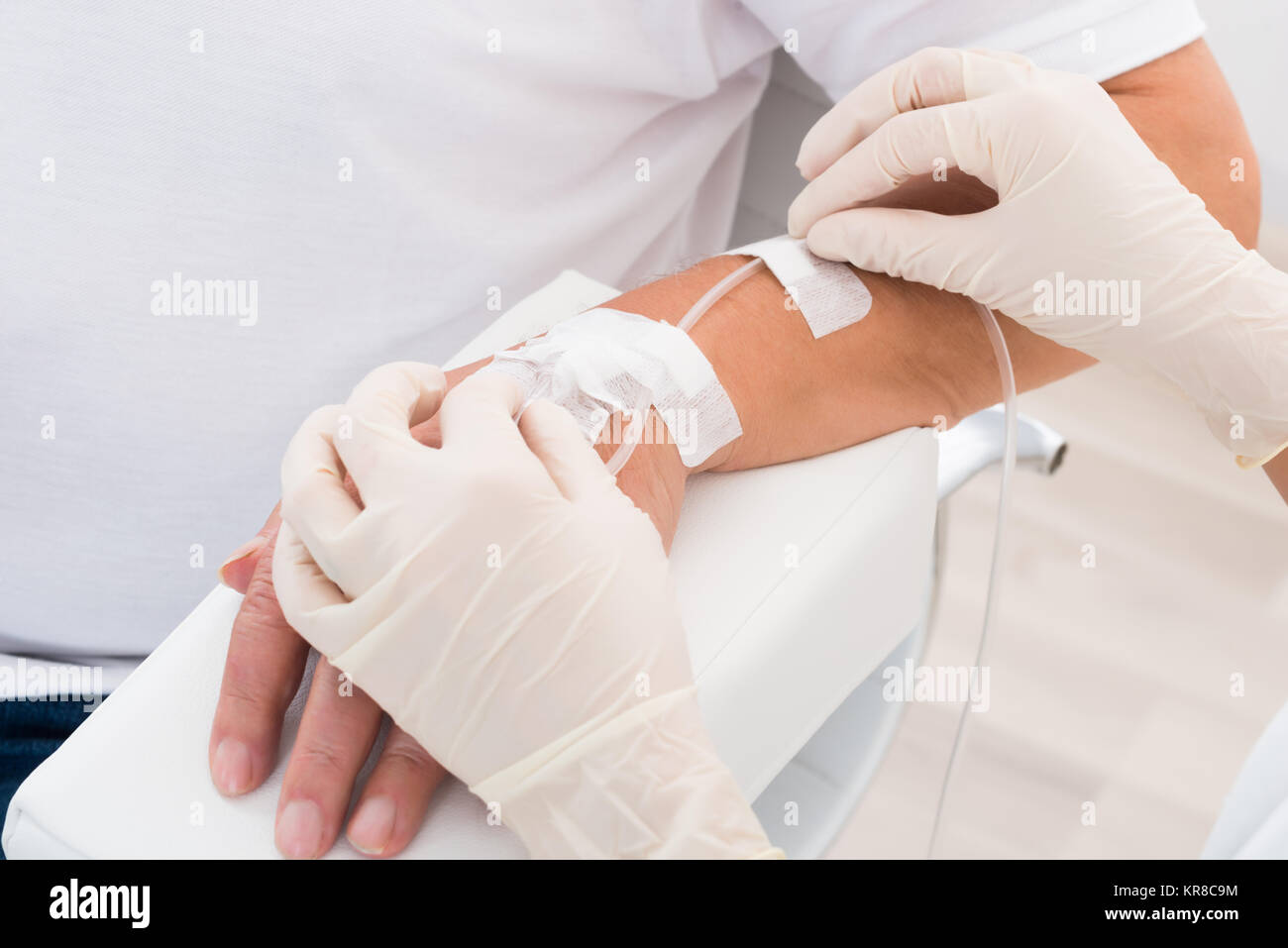 Iv Drip Inserted In Patient's Hand - Stock Image