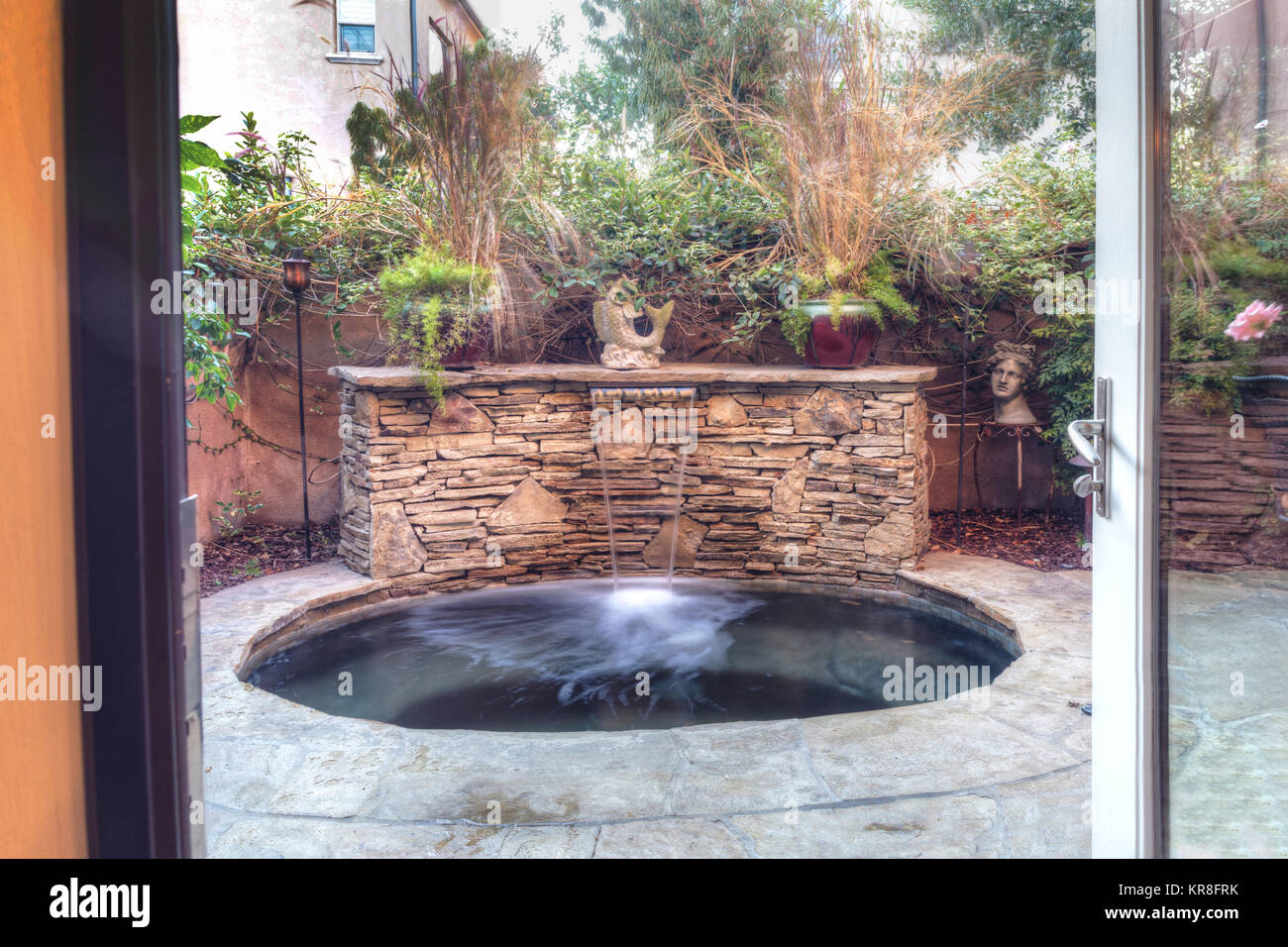Oval hot tub spa with waterfall Stock Photo: 169218439 - Alamy