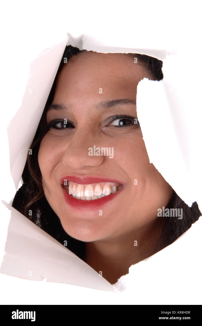 Woman looking through hole in paper. - Stock Image