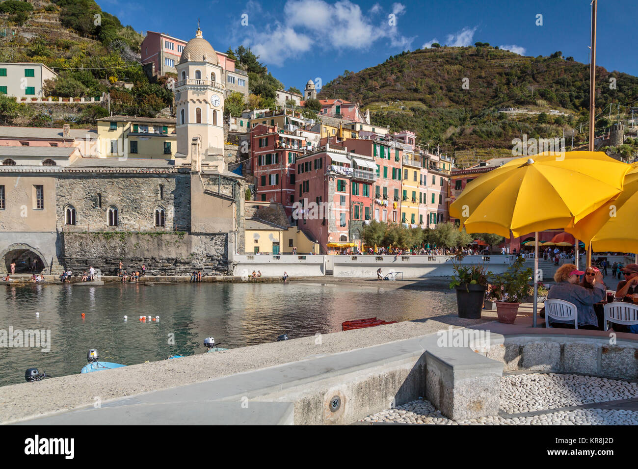 Yellow umbrellas at a portside restaurant in the village of Vernazza, Cinque Terre, Liguria, Italy, Europe. - Stock Image