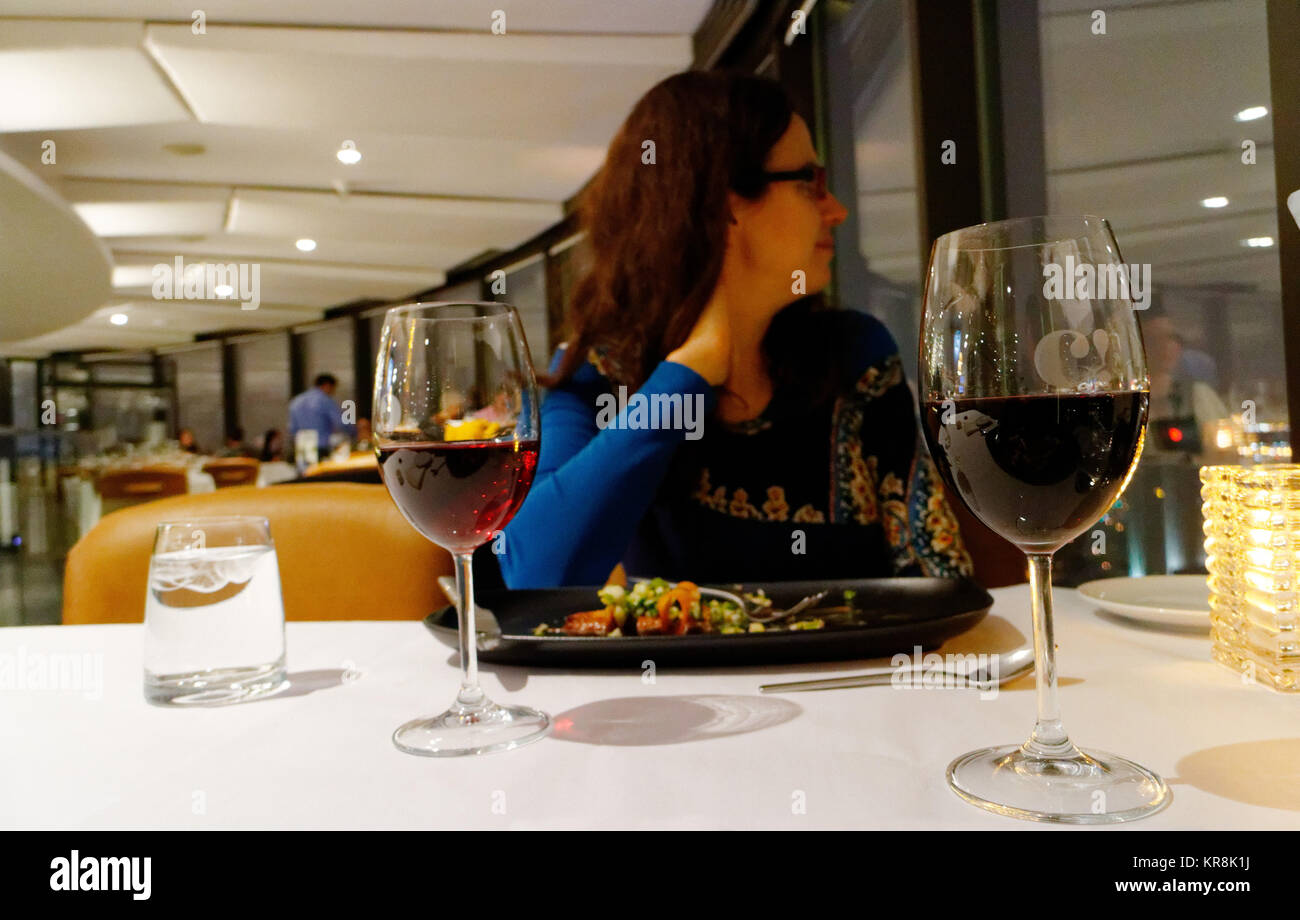 A lady diner looking at the view from the window is the Ciel! rotating restaurant in Qiebec City - Stock Image