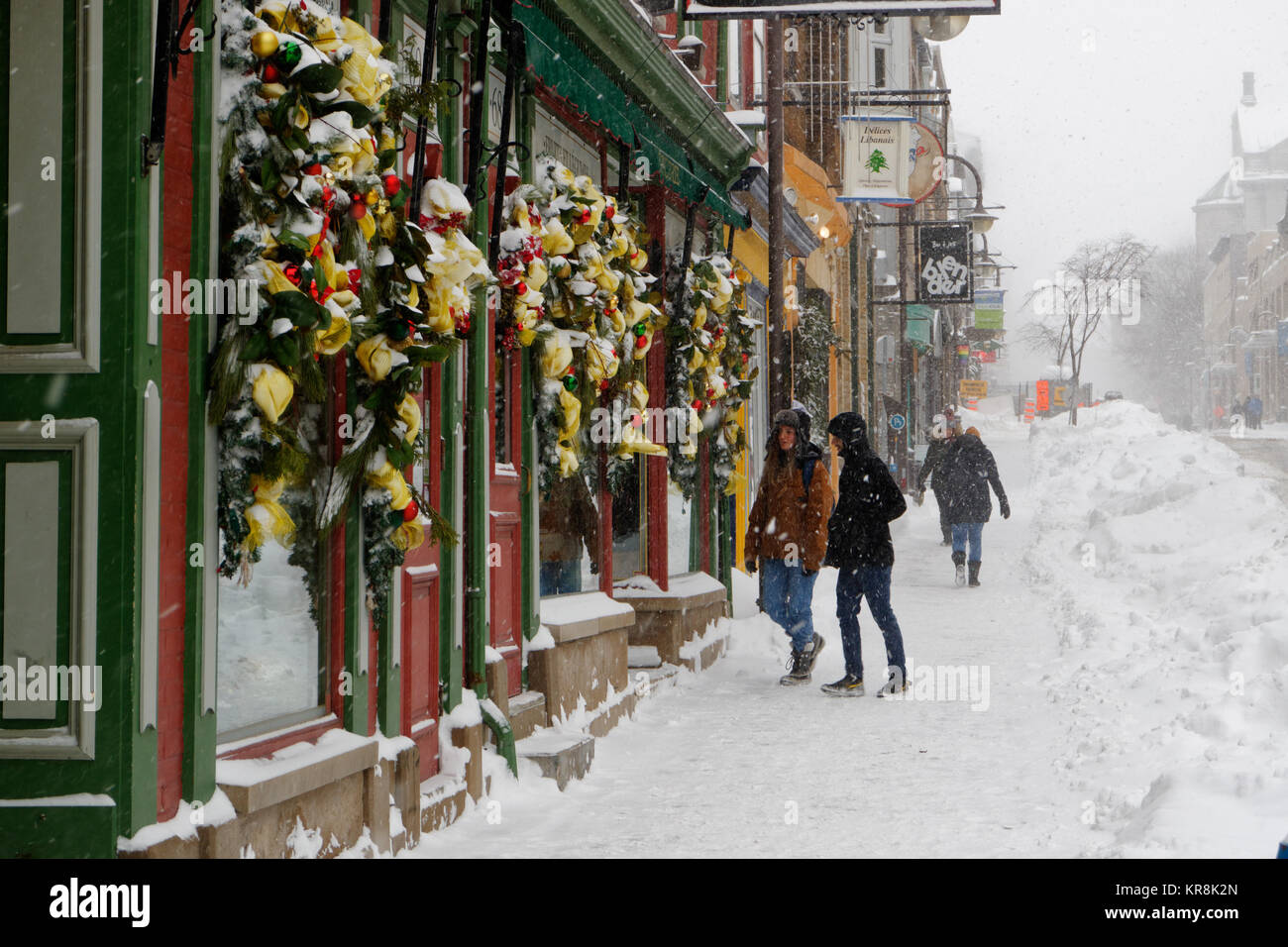 Snowy Rue St Jean in Quebec City during a heavy snowstorm, with the famous shop JA Moisan - Stock Image