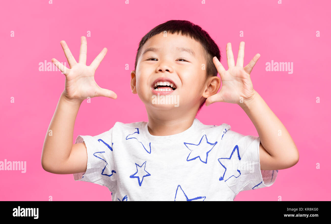 Excited little boy showing grimace Stock Photo