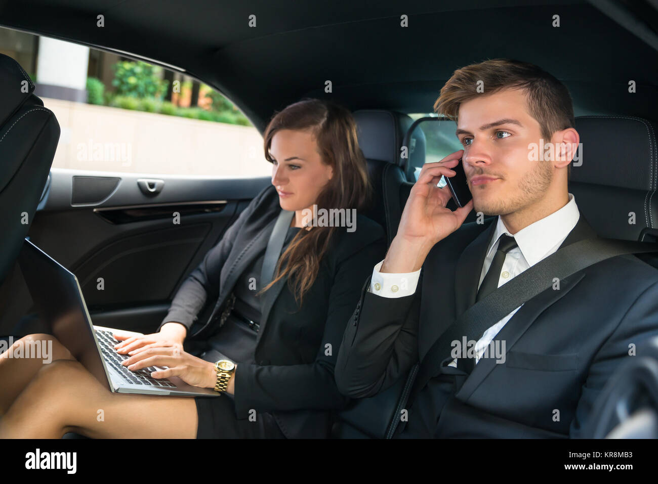 Businessman And Businesswoman In The Car - Stock Image