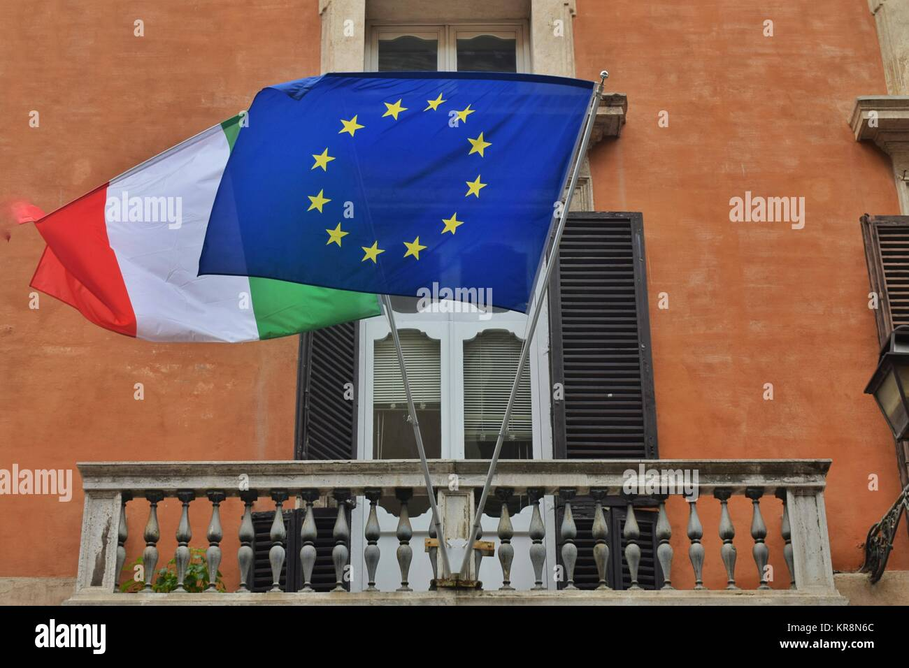 Flags of Italy and the European Union on a balcony of a building in the historic center of Rome - Stock Image