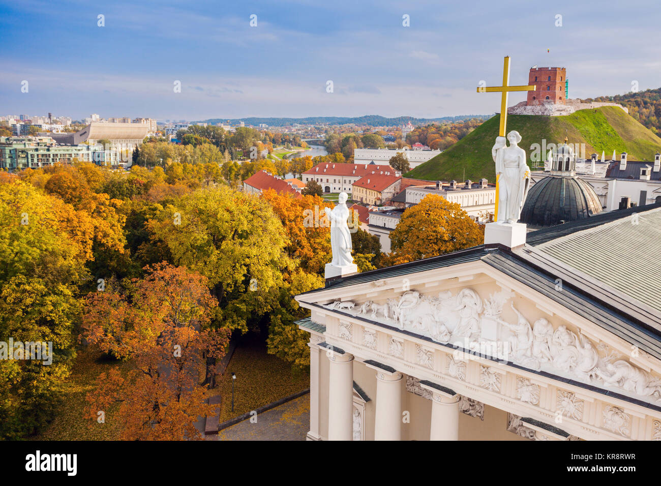 Lithuania, Vilnius, Vilnius cathedral roof with cityscape in background - Stock Image