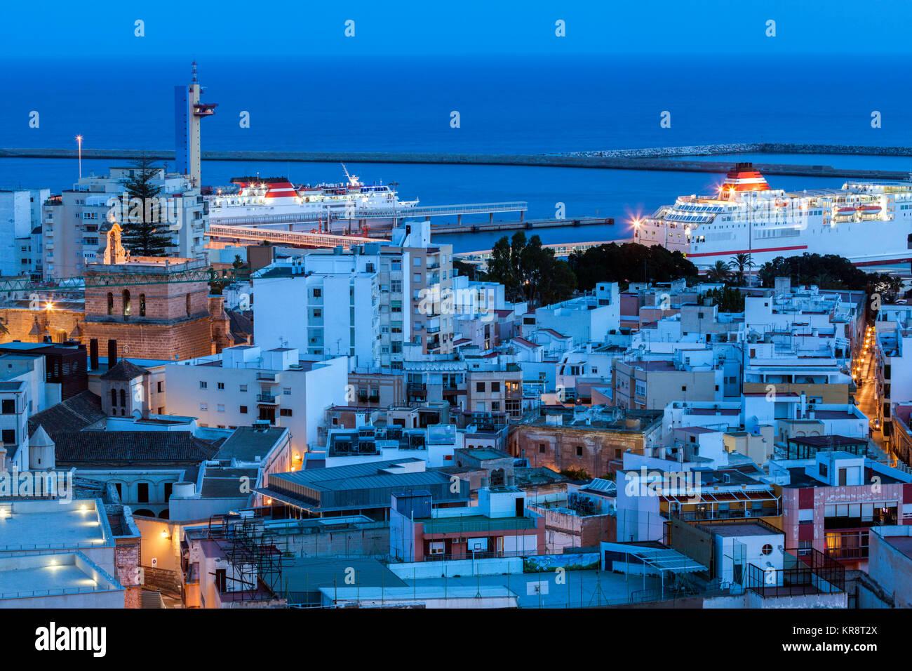 Spain, Andalusia, Almeria, Cityscape with sea at dusk - Stock Image