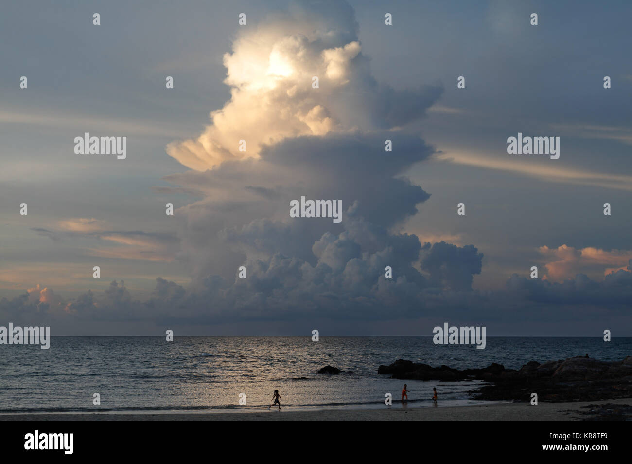 Towering cumulonimbus cloud at sunset in Malaysia - Stock Image