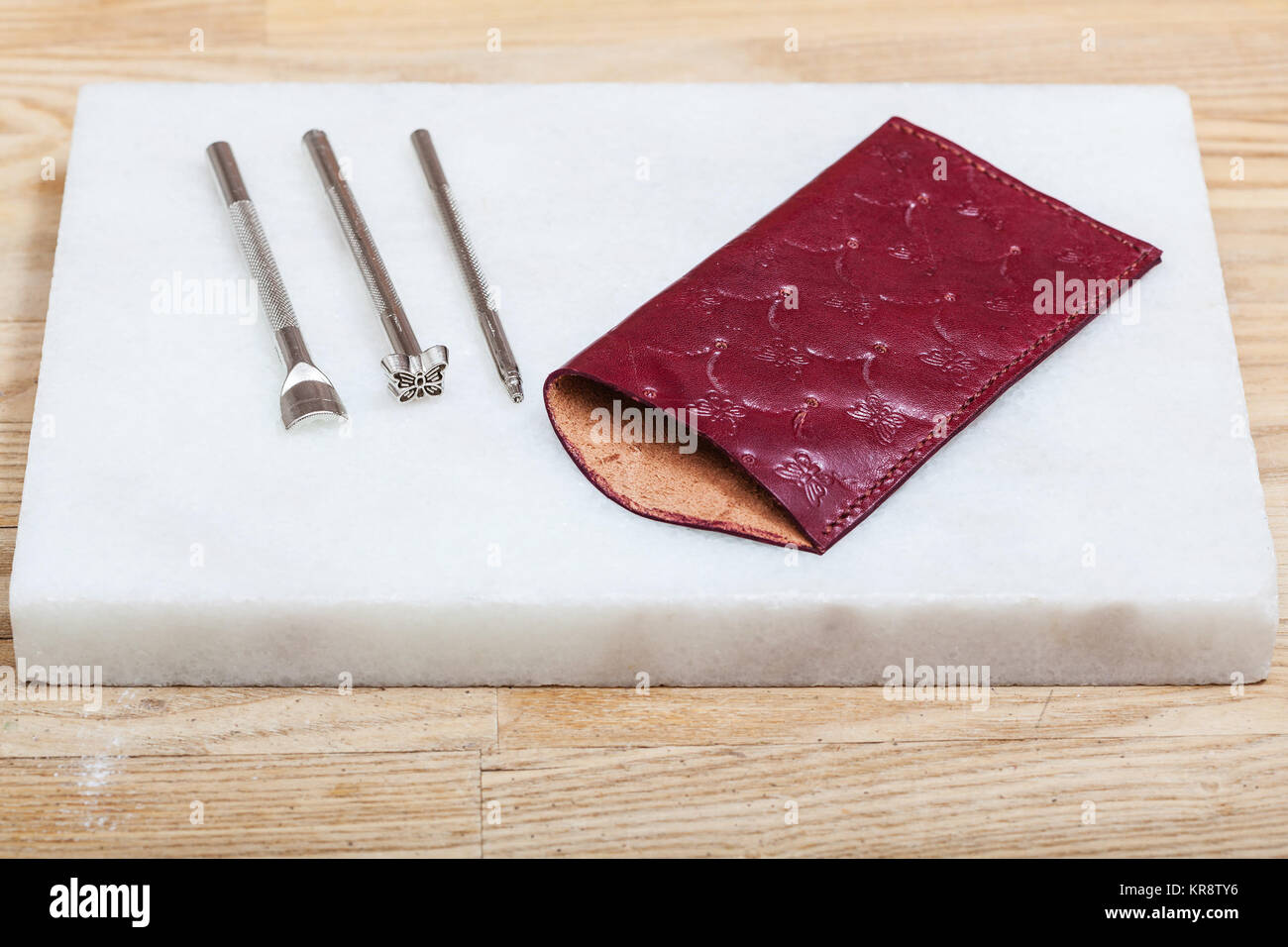 leather pouch for eyeglass and embossing tools - Stock Image