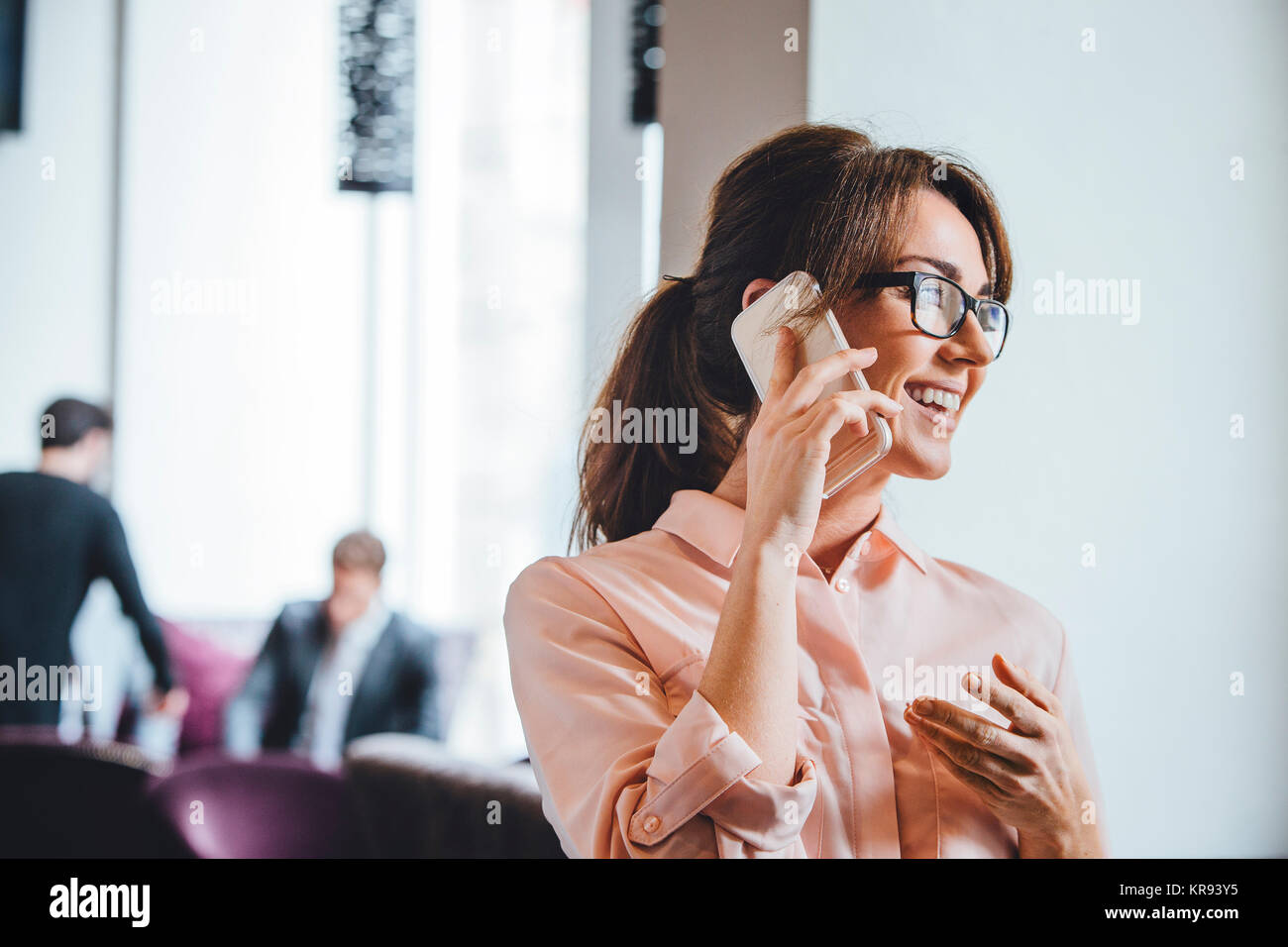 Business woman on the phone - Stock Image