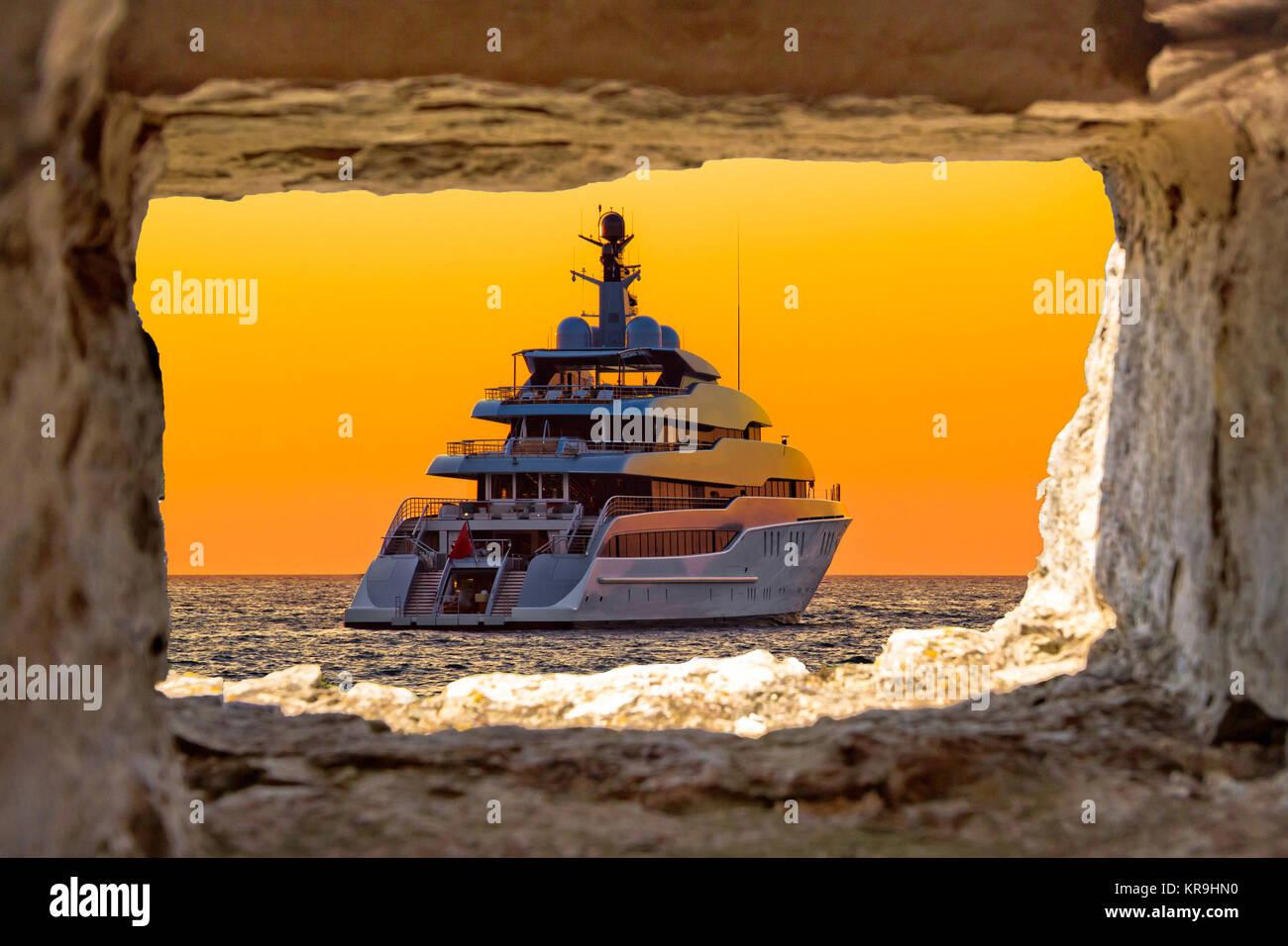 Luxury yacht through stone window view Stock Photo