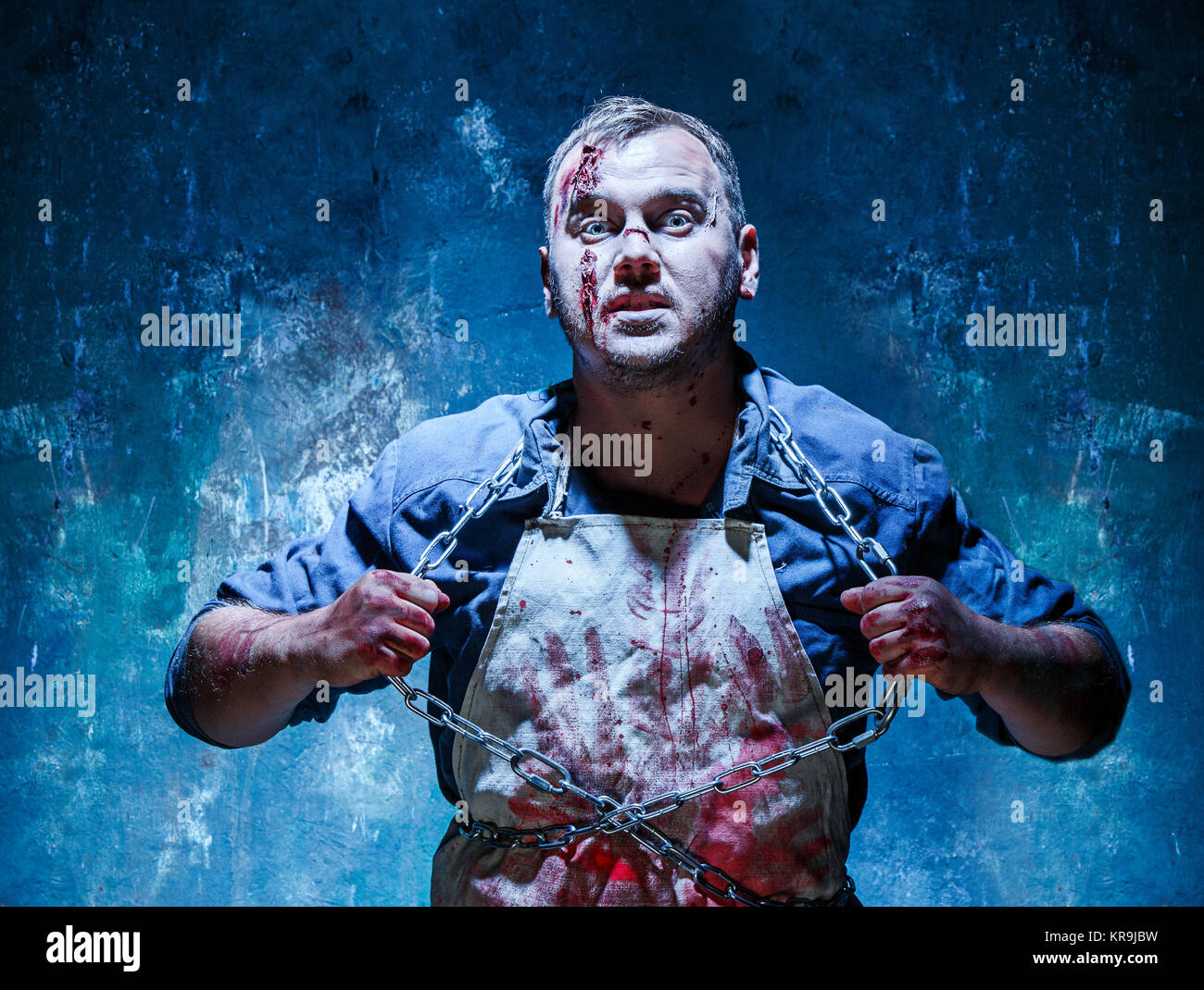 Bloody Halloween theme: crazy killer as butcher - Stock Image