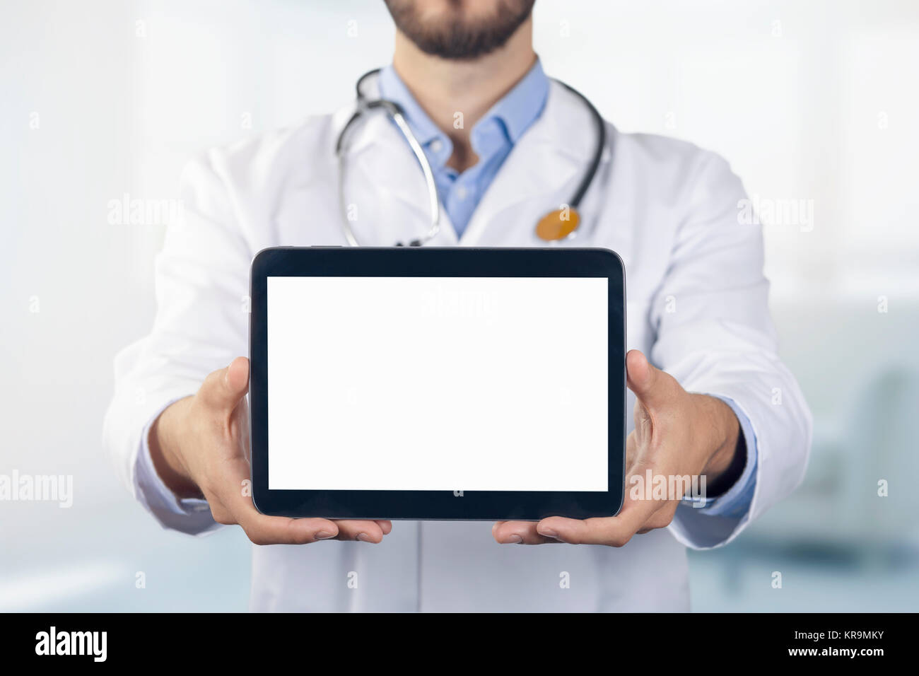 doctor showing digital tablet with blank white screen - Stock Image