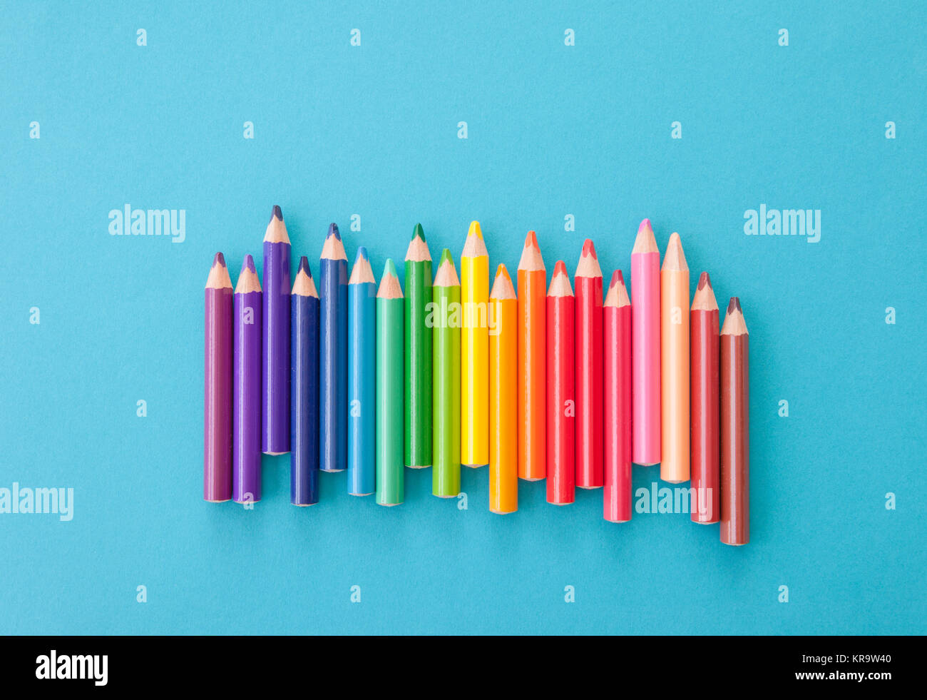 colorful pencils on blue - Stock Image