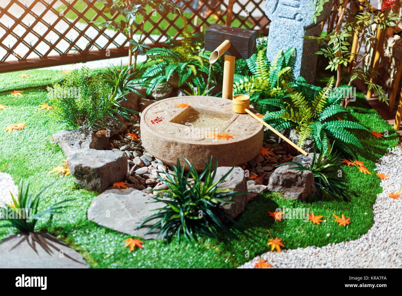 Japanese Stone Lantern In The Garden With Cho Zu Fountain And Maple.  Traditional Asian