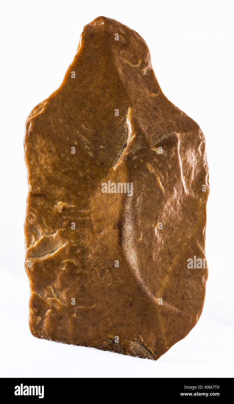 Ancient stone hand ax. Paleolithic period. - Stock Image