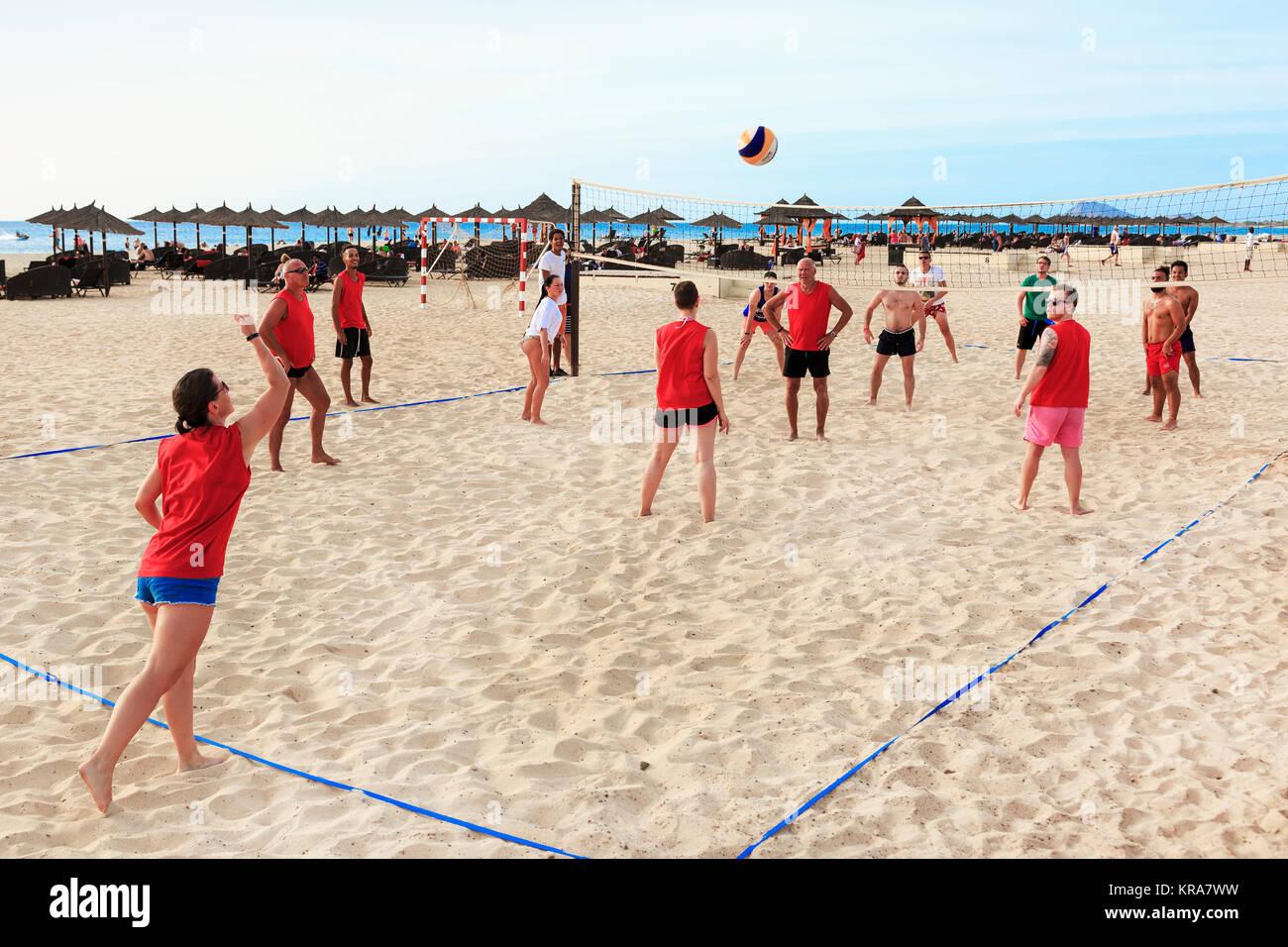 Tourists playing beach volleyball on Bikini Beach, Santa Maria, Sal Island, Salina, Cape Verde, Africa Stock Photo