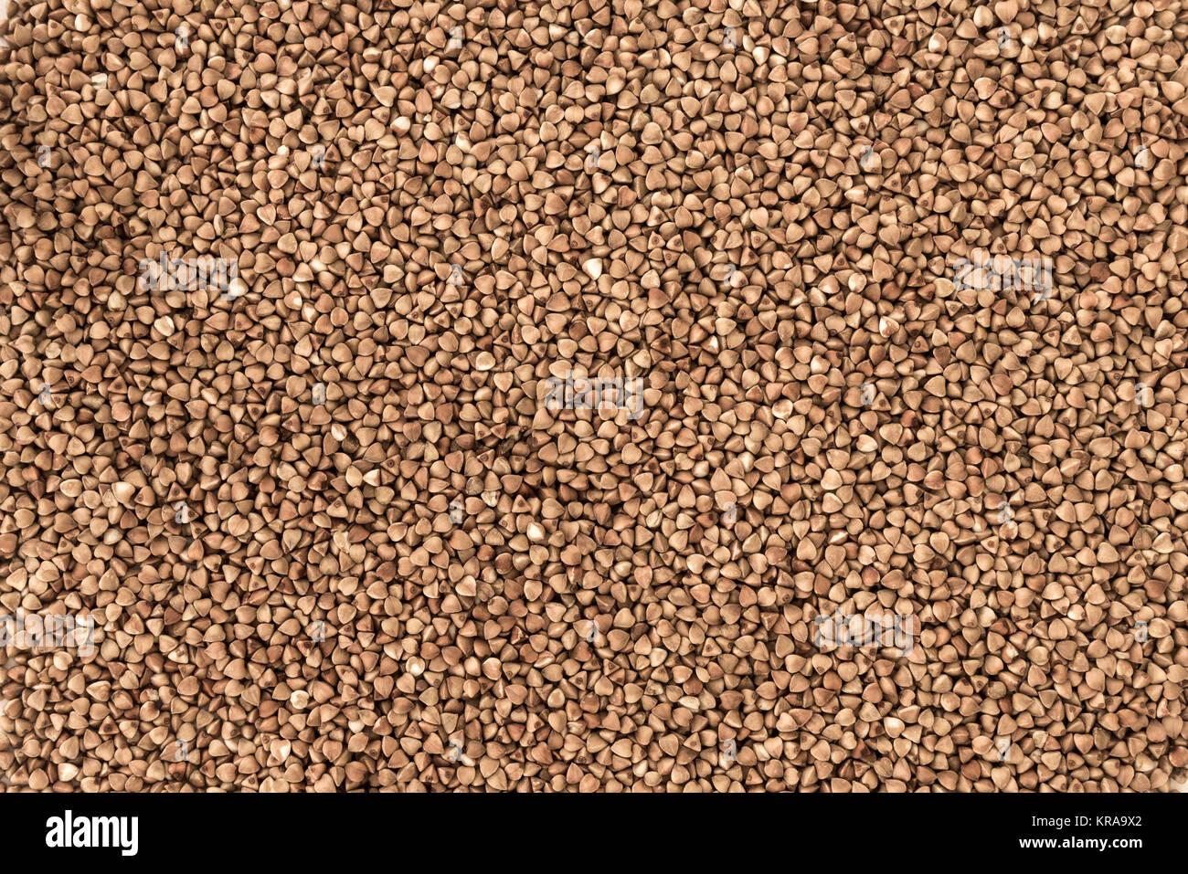 Dry Buckwheat Grain. Healthy Cereal Vegetarian Food Background - Stock Image