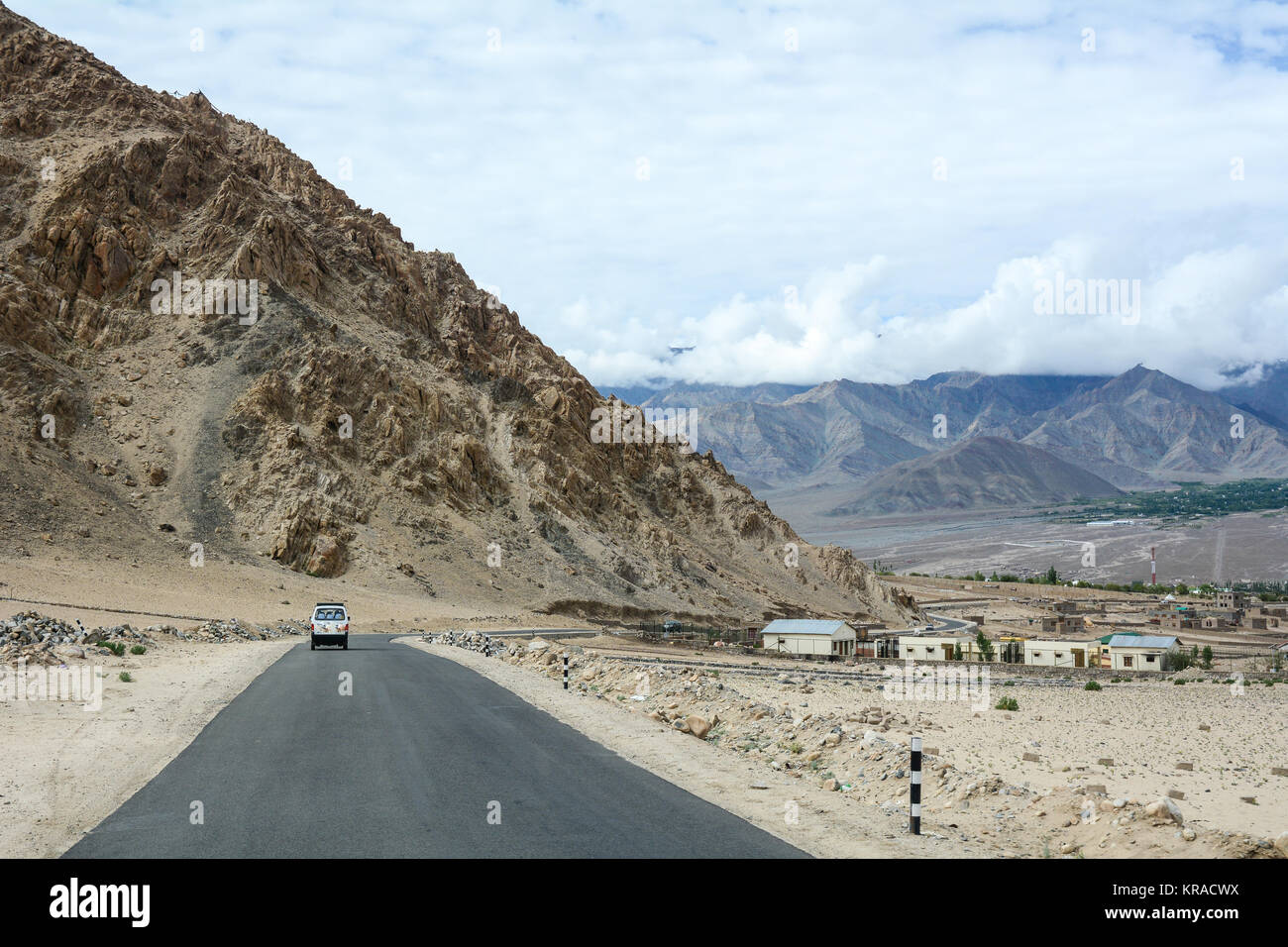 Mountain road in Ladakh, India. Ladakh is one of the most sparsely populated regions in Jammu and Kashmir. - Stock Image