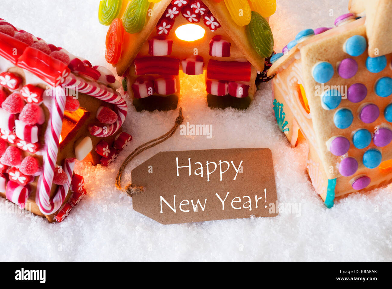 English new year greetings stock photos english new year greetings label with english text happy new yea colorful gingerbread house on snow christmas card m4hsunfo