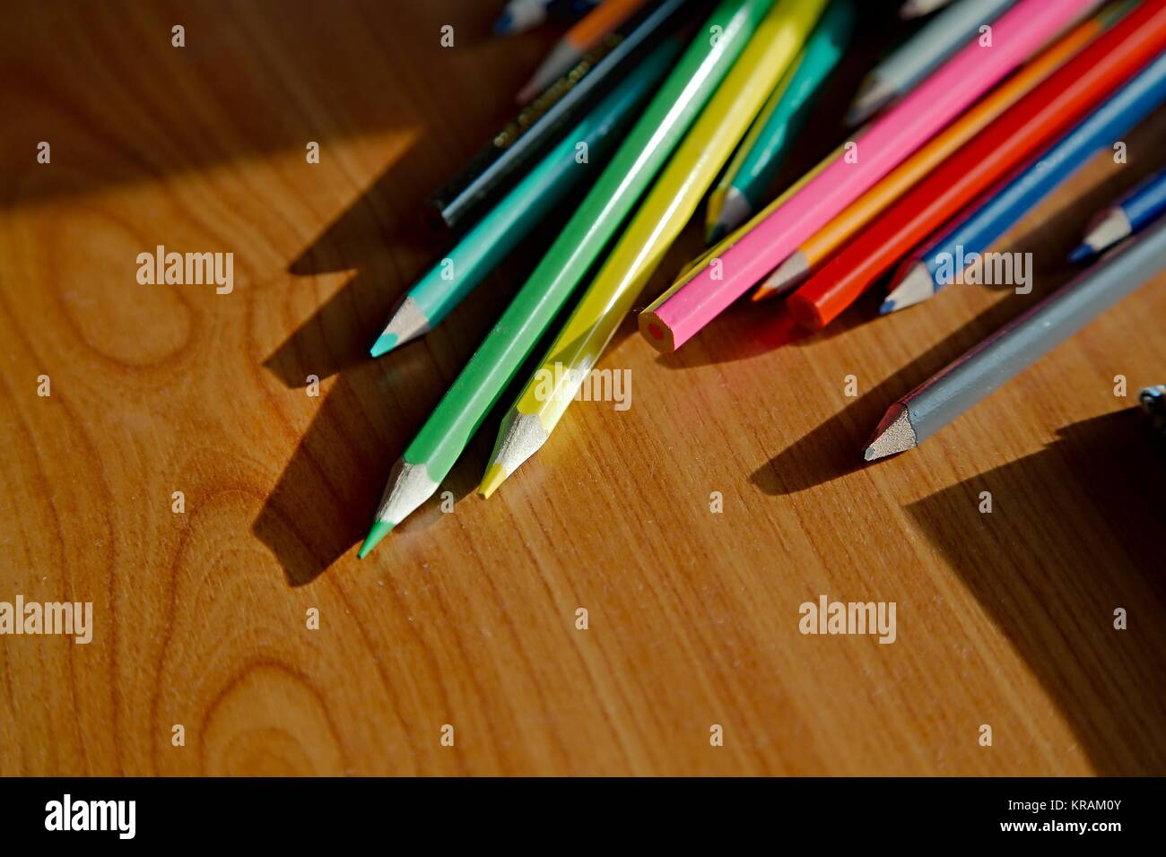 Color pencils on the desk - Stock Image