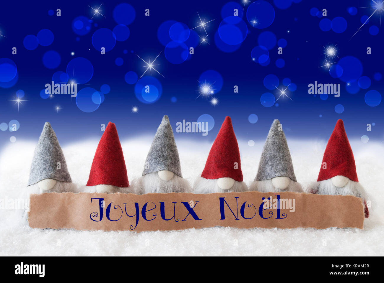 Label with french text joyeux noel means merry christmas christmas label with french text joyeux noel means merry christmas christmas greeting card with gnomes sparkling bokeh and blue background with snow and stars m4hsunfo