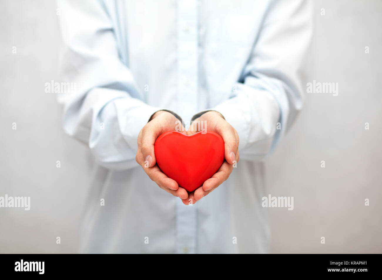 Red heart in hands - Stock Photo