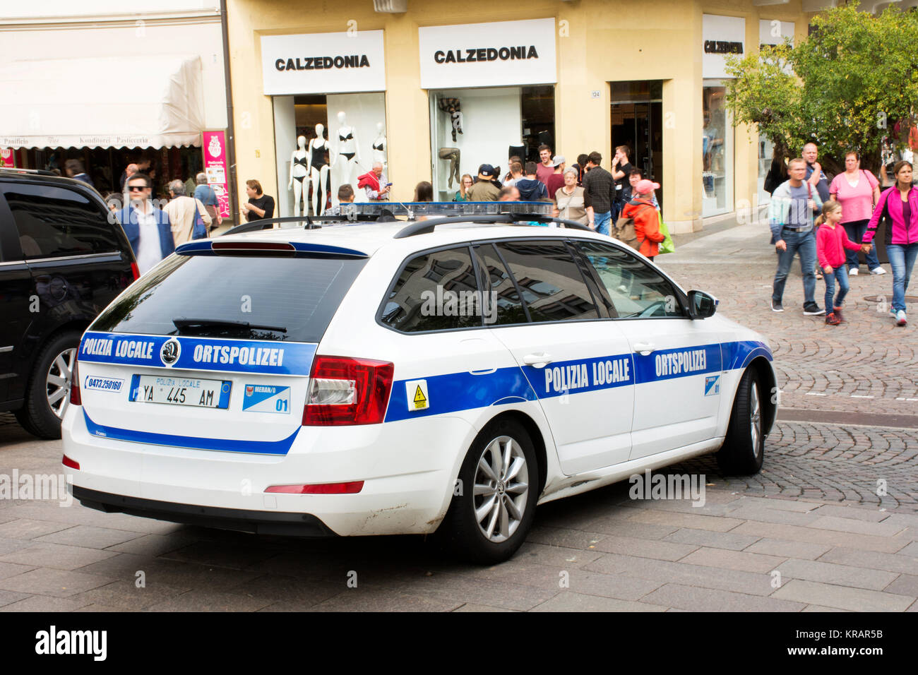 Italian policemen people driving cop car on the road check over