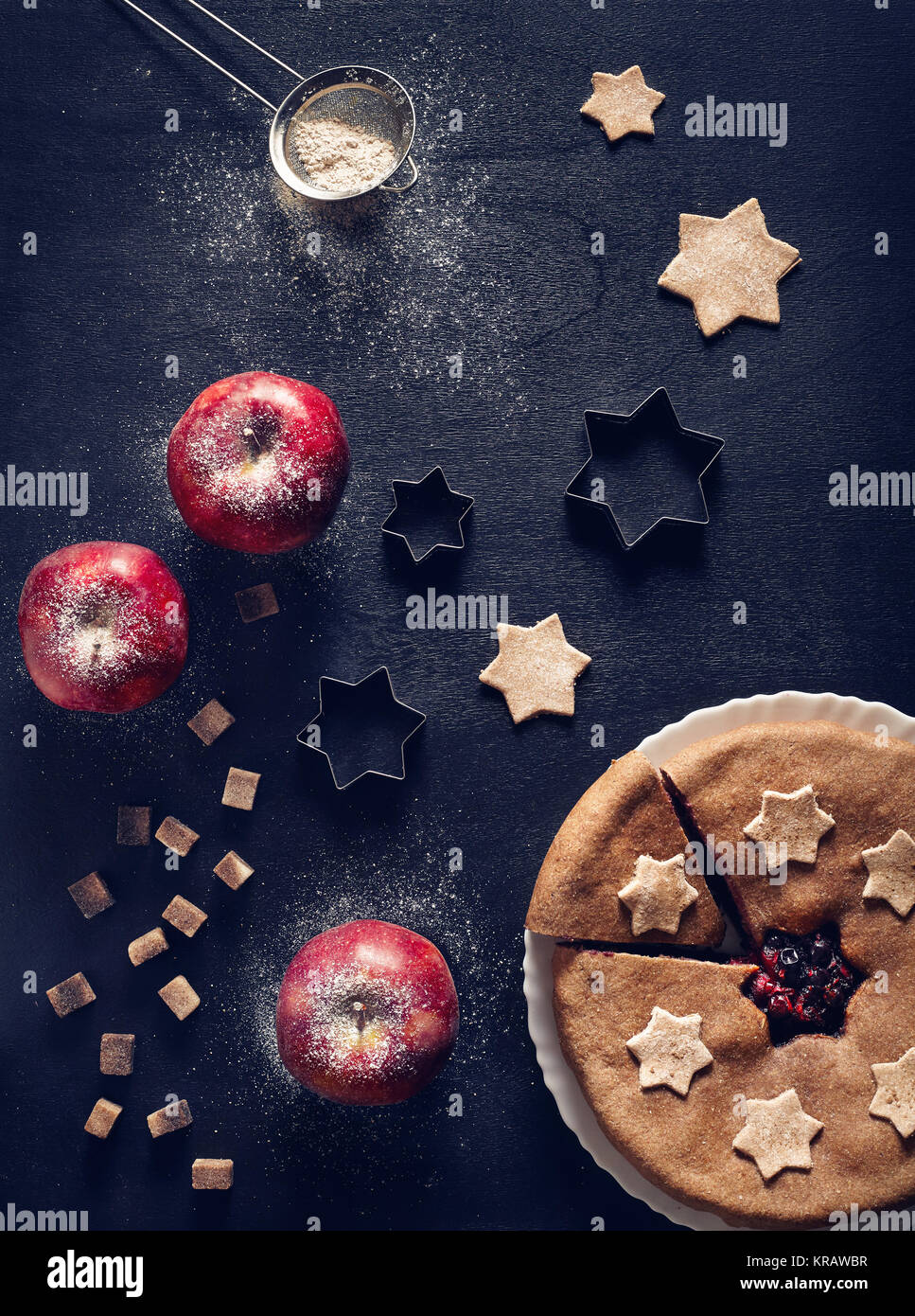 Vegan homemade pie from currant and apples on black background - Stock Image