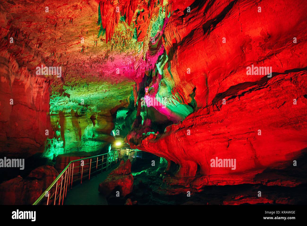 Underground cave Sataplia with colorful red illumination in Kutaisi, Georgia - Stock Image