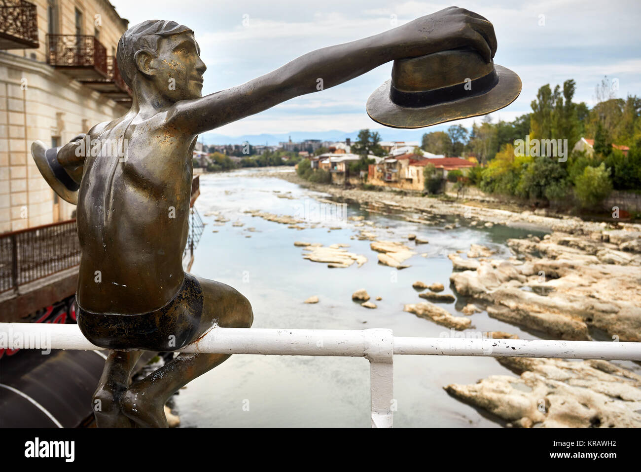 Sculpture of Boy with hat on the bridge in the central Kutaisi, Georgia - Stock Image