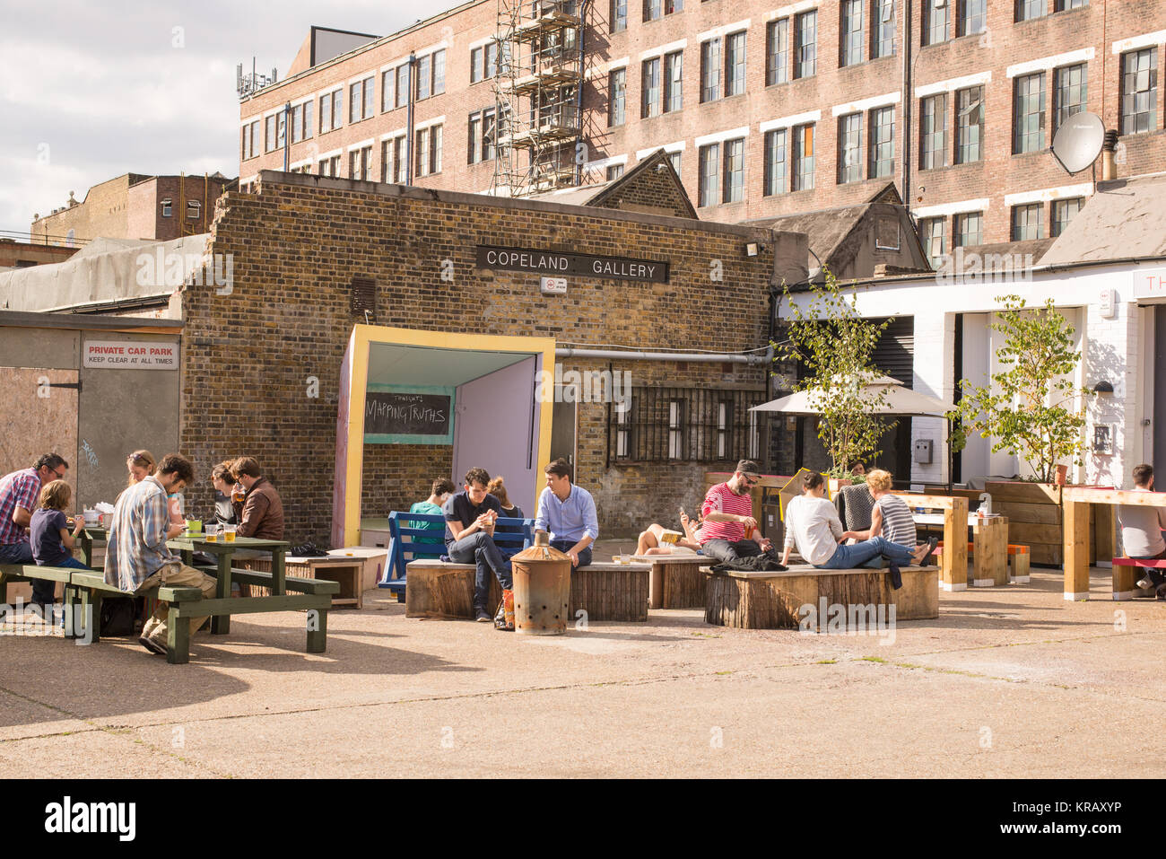 Outdoor stalls hipster cafe with people enjoying the summer at the alternative indie famous venue the Copeland Gallery - Stock Image