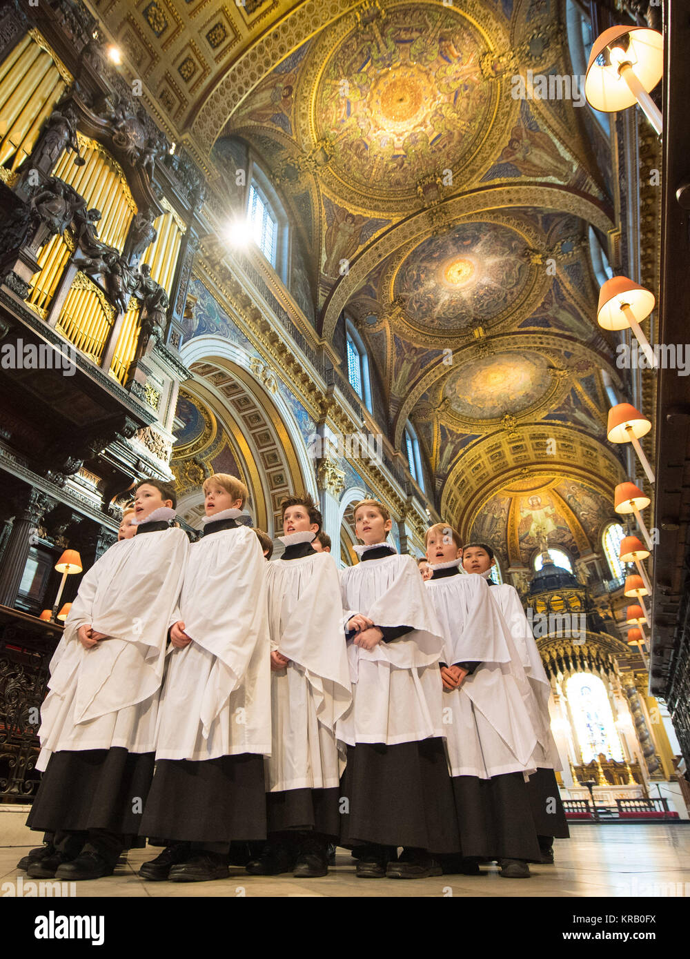 Choristers in St Paul's Cathedral in London rehearse before their busiest weeks of the year. Stock Photo