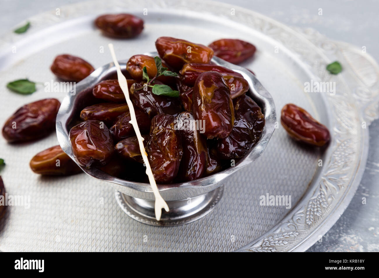 Dry fruit dates on silver tray. Copy space - Stock Image