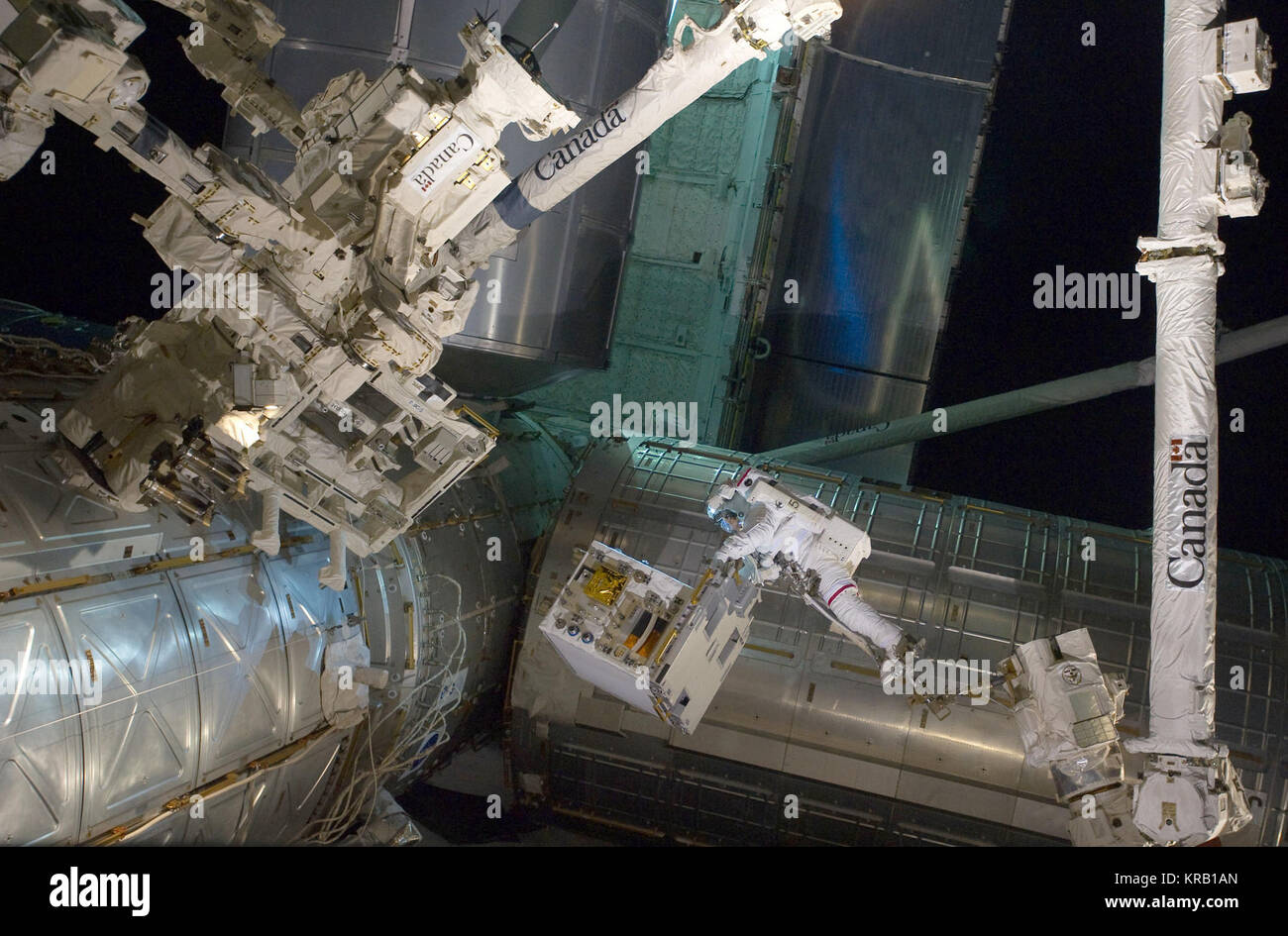 NASA image captured July 12, 2011  With his feet secured on a restraint on the space station remote manipulator Stock Photo