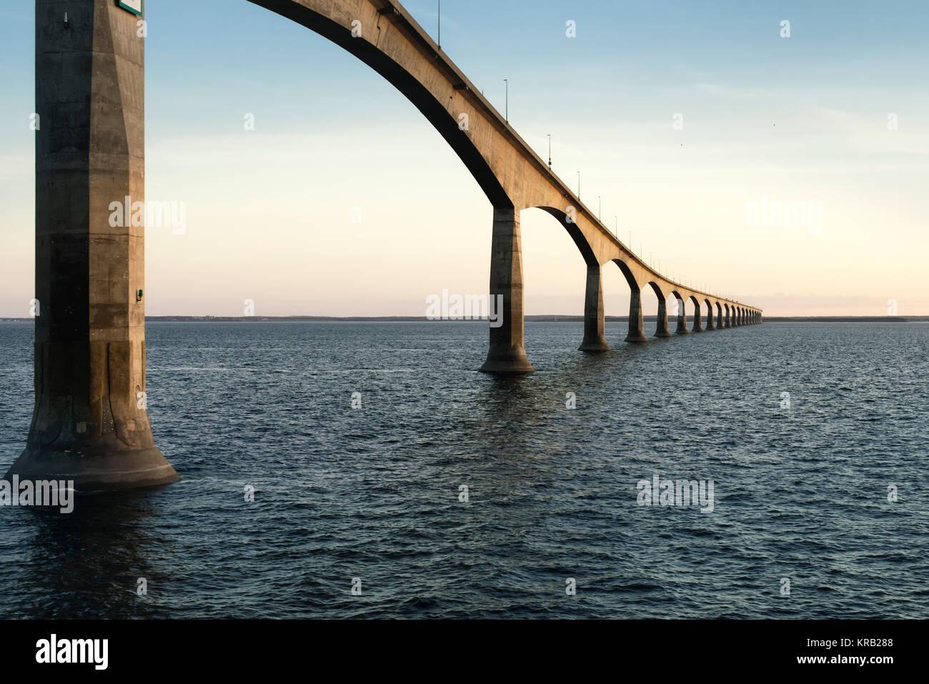 Confederation Bridge over sunset sky, Northumberland Strait, Prince Edward Island, Canada Stock Photo