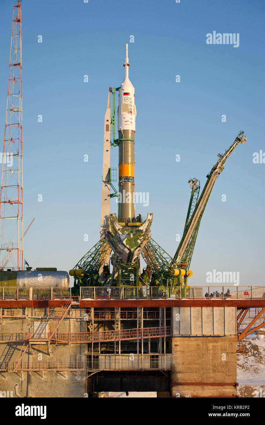 The Soyuz TMA-03M spacecraft is seen at the launch pad after being raised into vertical position on Monday, Dec. - Stock Image