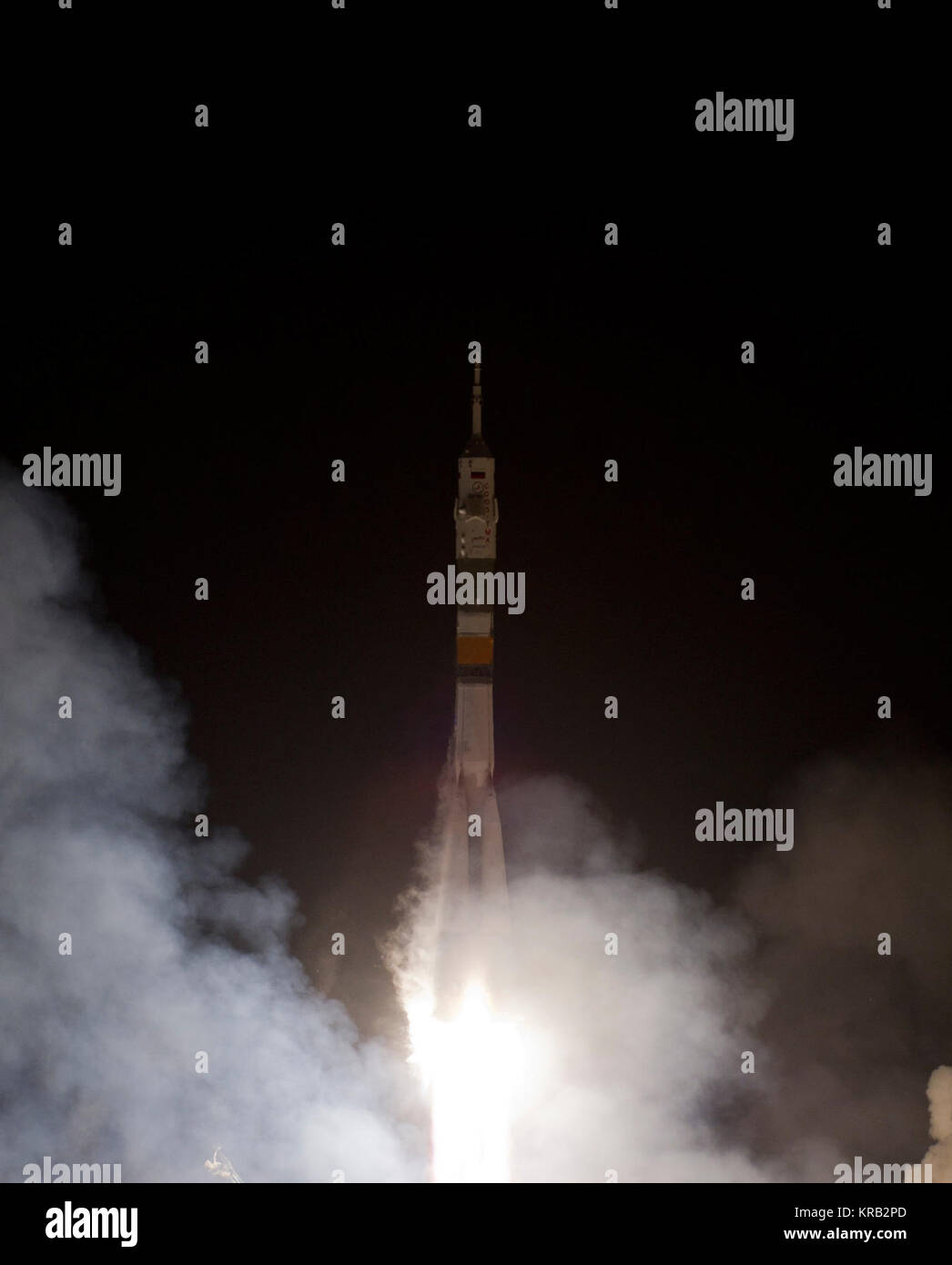 The Soyuz TMA-03M rocket launches from the Baikonur Cosmodrome in Kazakhstan on Wednesday, Dec. 21, 2011 carrying - Stock Image