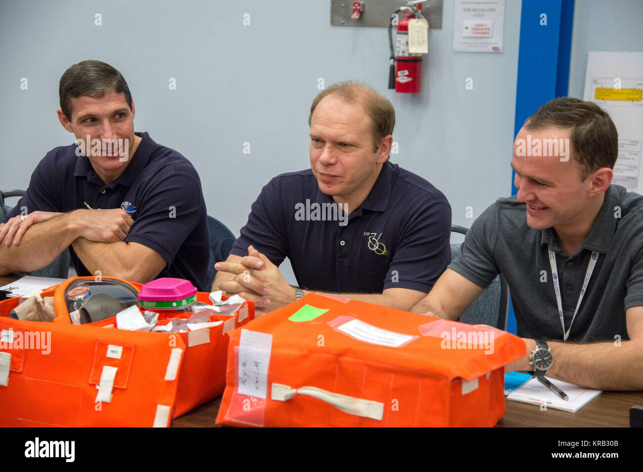 DATE: 1-24-13 LOCATION: Bldg. 9NW - ISS Mockups  SUBJECT: Expedition 38 crew members, Kotov, Ryazansky and Mike - Stock Image
