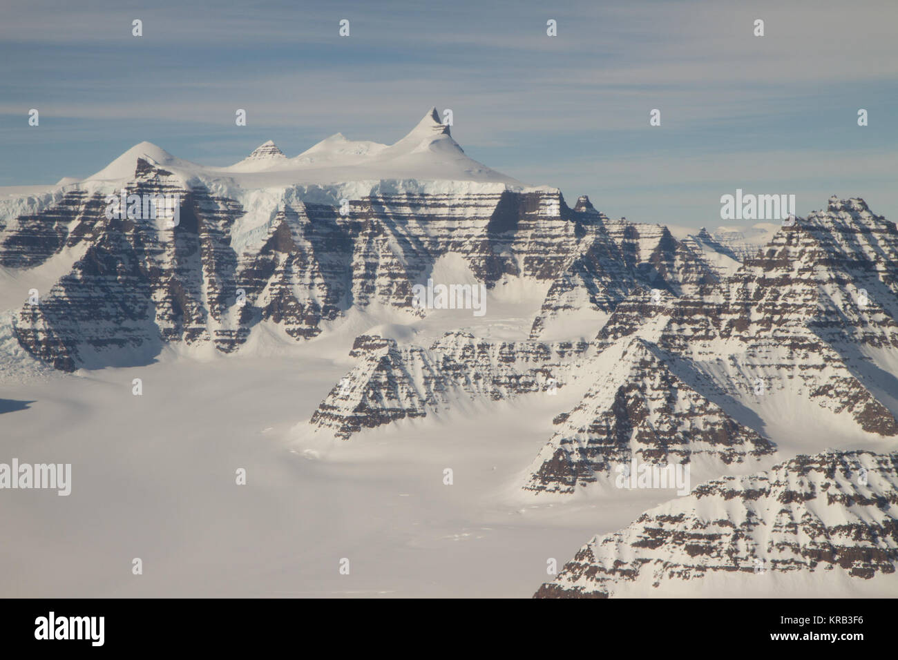 Mountain ridges showing the distinctive geology of the Geikie Plateau region in eastern Greenland, as seen from - Stock Image