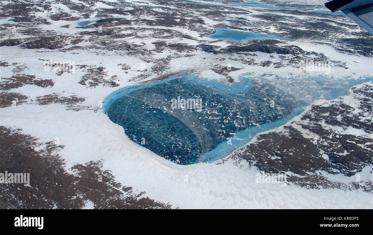 Frozen meltwater lake along the northeast Greenland coast, as seen from NASA's P-3B aircraft on May 7, 2012. - Stock Image