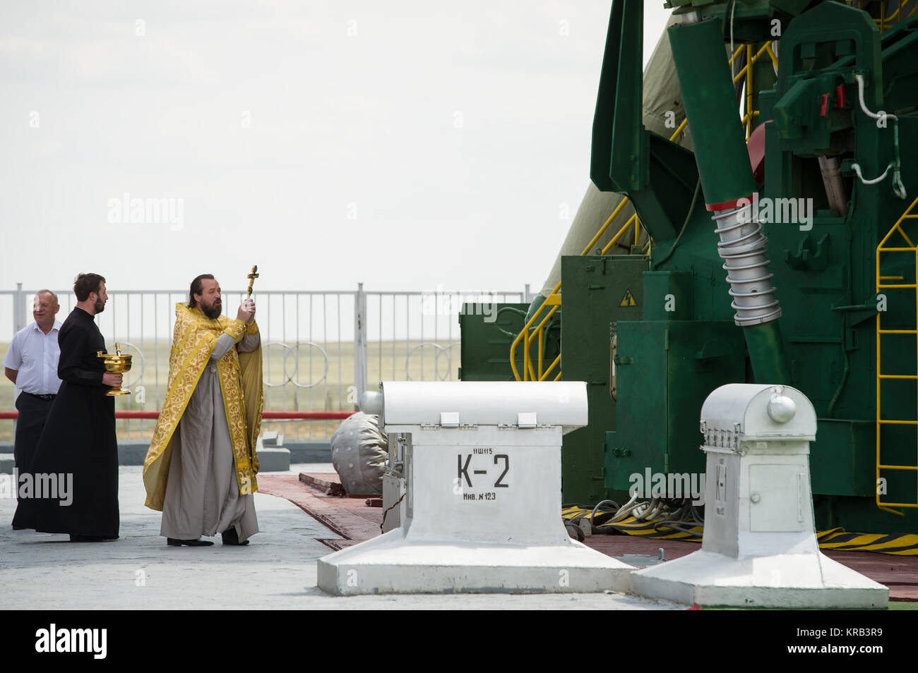 An Orthodox priest blesses the Soyuz rocket at the Baikonur Cosmodrome Launch pad on Monday, May 14, 2012 in Kazakhstan. - Stock Image